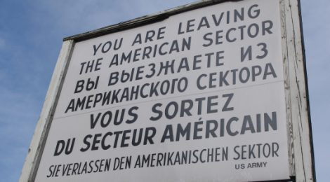A sign above the Berlin Wall