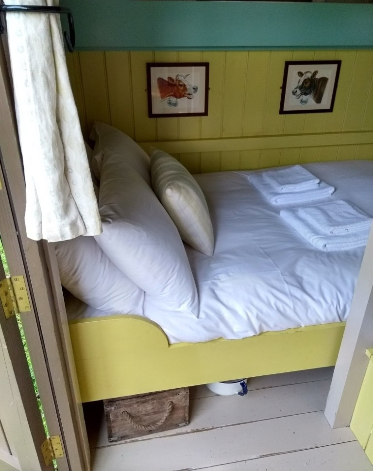 The comfy bed in the Wriggly Tin Shepherd's Huts