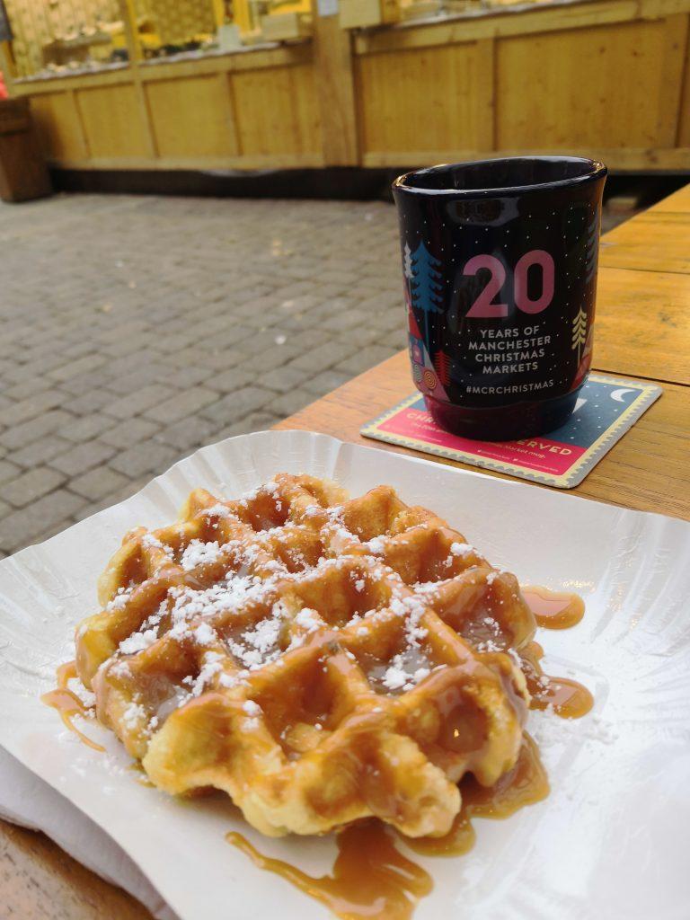 Waffle and mug celebrating 20 years of Manchester Christmas Markets