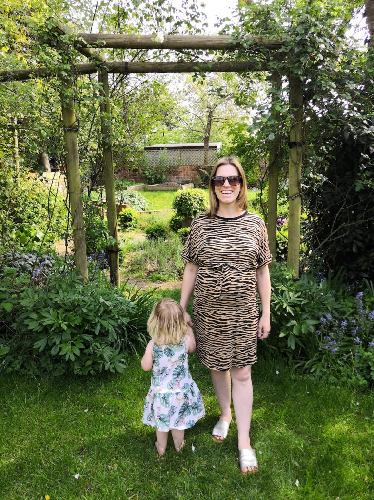 Mum and daughter stand in garden