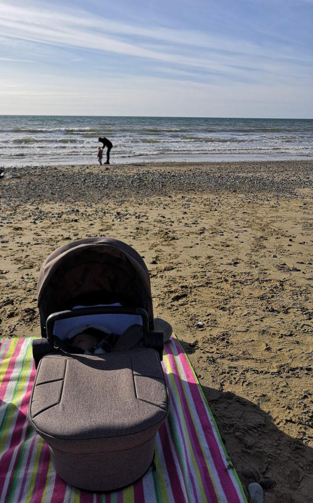 The little adventurer lies on the beach