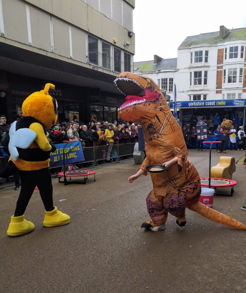 This image has an empty alt attribute; its file name is Pancake-Day-races-Scarborough-dino-858x1024.jpg