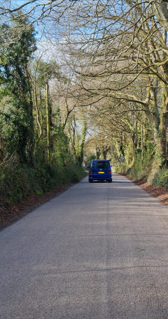 A VW campervan driving away