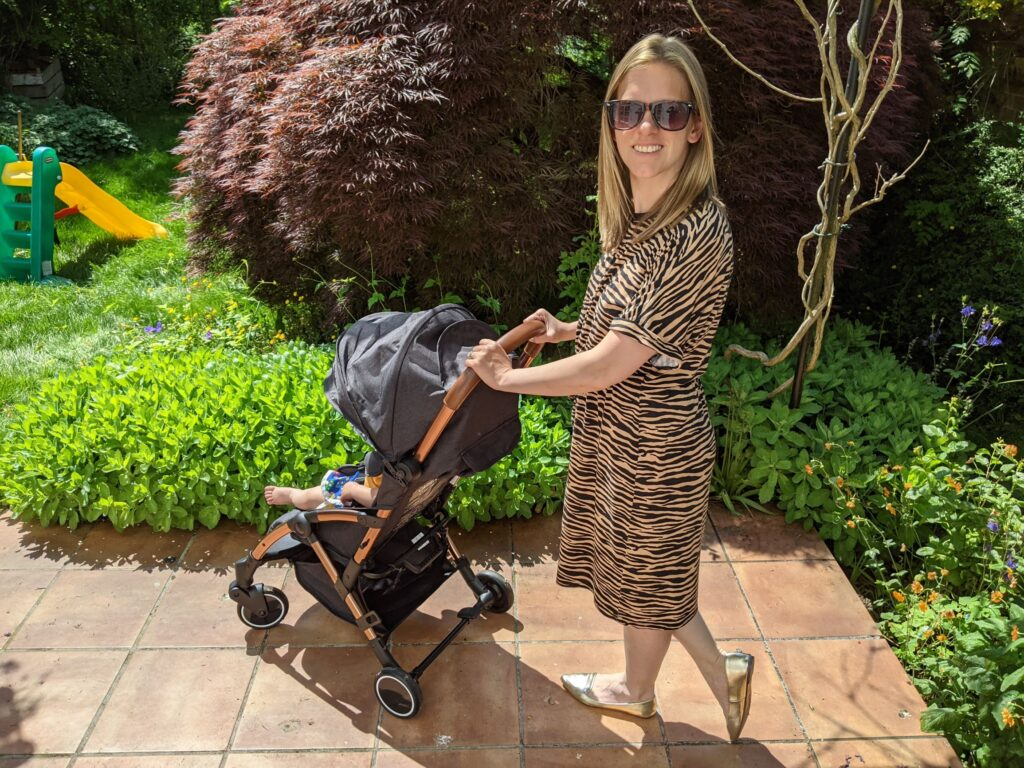 Ickle Bubba Globe stroller with baby